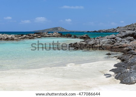 Coast of Crete island in Greece. Sandy beach with transparent clean water azure color