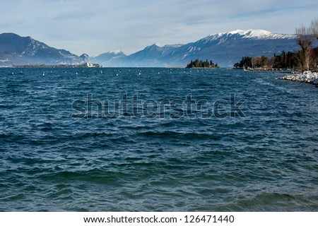 coast of garda lake, desencano, italy (with the alps)