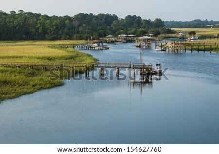 coast of georgia grass marsh boat docks - stock photo