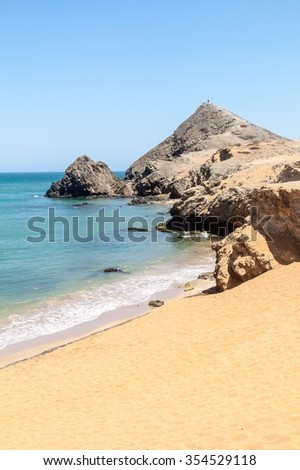 Coast of La Guajira peninsula in Colombia. Beach Playa del Pilon. Pilon de Azucar hill in the background.