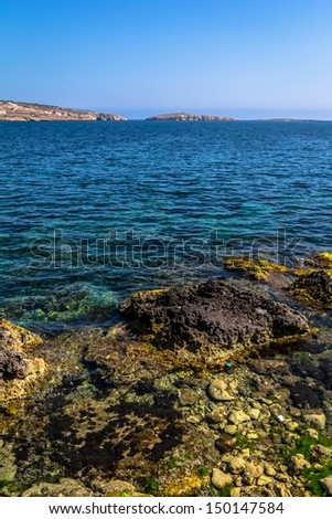 Coast of Malta with St Paul�s islands in the background.