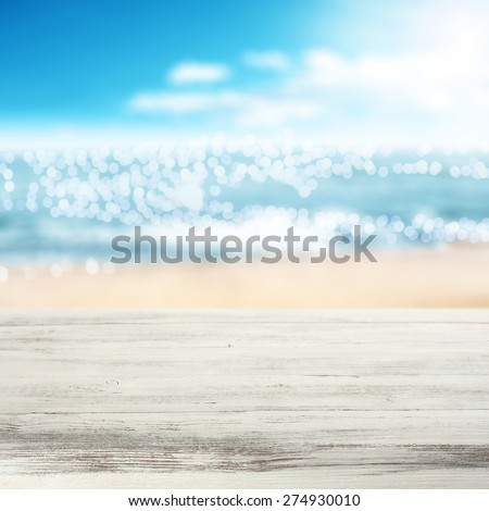 coast of sea in blurred background and white desk  - stock photo