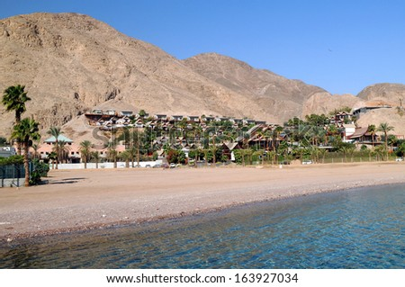 Coast of the Red Sea in Israel with mountains in the background - stock photo
