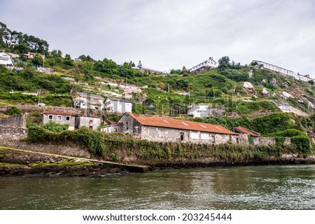 Coast of the River Douro with its beautiful architecture in Porto, Portugal. View from the River Douro, one of the major rivers of the Iberian Peninsula (2157 m) - stock photo