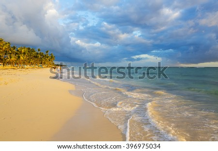 Coast of the tropical island. Morning sun. Beautiful place for restoration of forces, rest, aquatics, suntan and bathing. Warm sea water, white sand, breeze. - stock photo