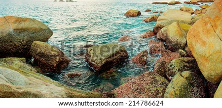 Coast of the tropical sea with big stones. Thailand, Phuket island - stock photo