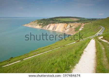 Coast path Alum Bay Isle of Wight beautiful beach and rocks next to the Needles tourist attraction - stock photo