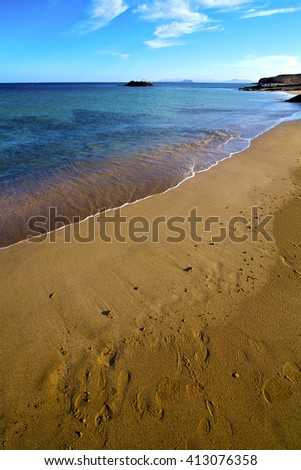 coast people stone volcanic spain  water in lanzarote  sky cloud beach  and summer  - stock photo