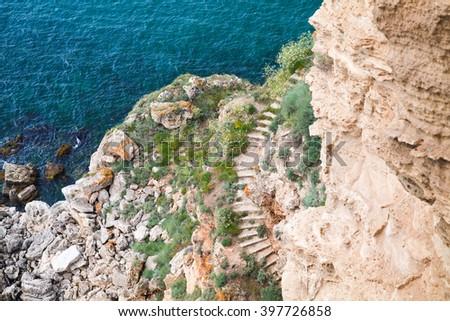 Coastal cliff with stone stairway. Bulgaria, Black Sea Coast, Kaliakra headland - stock photo