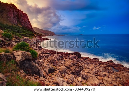 Coastal Landscape of Sicily in the Morning. Cloudy sky and waves at the sea