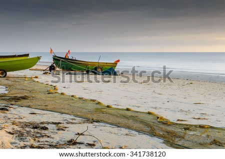 Coastal landscape with boats and nets of fishermen, Baltic Sea, Latvia - stock photo