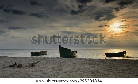 Coastal landscape with fishing boats anchored at sandy beach of the Baltic Sea - stock photo