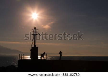 Coastal landscape with lighthouse in the morning with people in relaxation