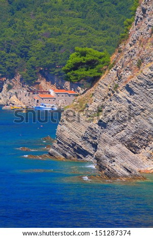 Coastal line of Adriatic sea with tall cliffs covered by vegetation - stock photo