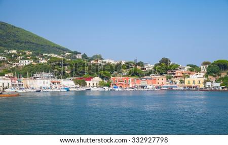 Coastal panoramic landscape, port of Ischia island. Mediterranean sea, Bay of Naples, Italy - stock photo