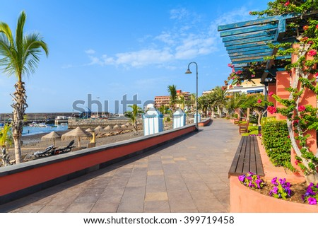 Coastal promenade along a tropical beach in San Juan town on Tenerife, Canary Islands, Spain - stock photo