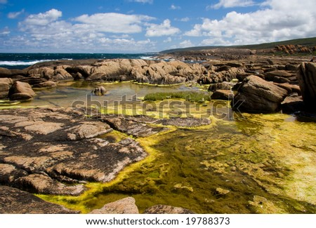 Coastal rock pools - stock photo