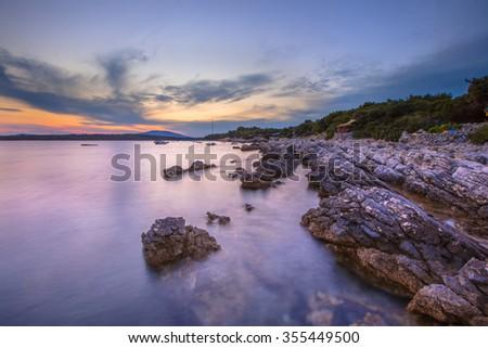 Coastal rock shelves on Cres Island in the Adriatic Sea, Croatia, Europe - stock photo