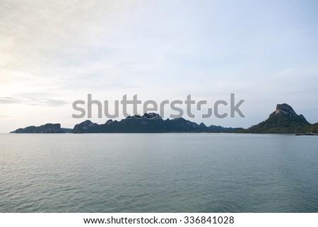 Coastal sea. The mountain-fringed coast. During the morning a cold. - stock photo
