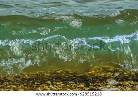 Coastal sea wave with clean transparent water. Close up