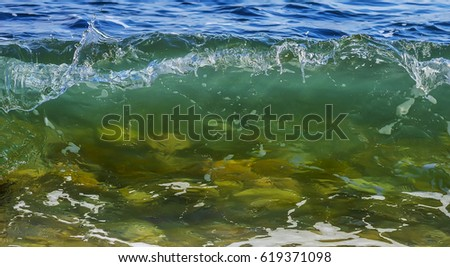 Coastal sea wave with clean transparent water. Close up. Copy space