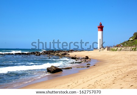 coastal seascape with beach ocean and lighthouse at Umhlanga Durban South Africa - stock photo