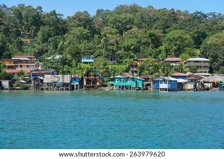 Coastal village of Old Bank with Caribbean houses and lush tropical vegetation, Bastimentos island, Bocas del Toro, Panama - stock photo