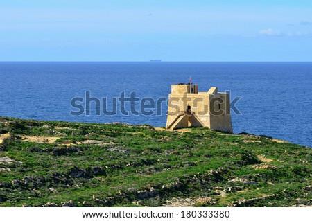 coastal watchtower on island Malta - stock photo