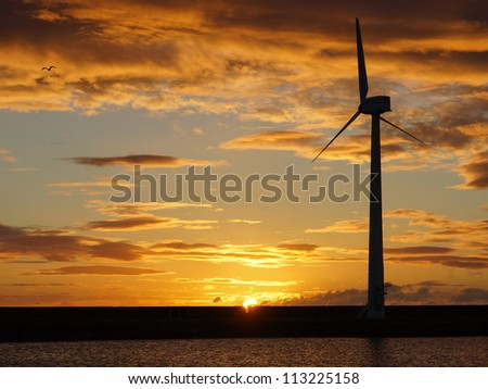 Coastal Wind Turbine At Daybreak