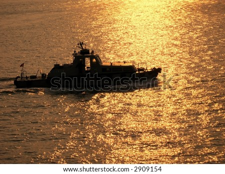 Coastguard Ship -- crossing the sea during sunset time