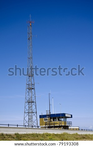 Coastguard station; next to radio mast, against deep blue summer sky; excellent copy-space