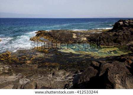 coastline in lanzarote spain pond  rock stone sky cloud beach  water  musk  and summer     - stock photo