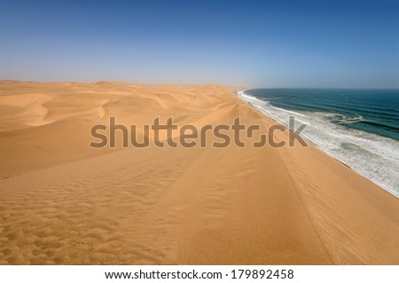 Coastline in the Namib desert near Sandwich Harbor. Sandwich Harbor is part of the Namib Naukluft National Park, and is one of the biggest sand fields in the world and a UNESCO world heritage site.  - stock photo