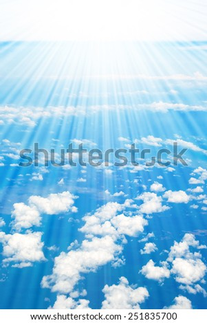 Coastline, mountains, ocean and clouds airplane view - stock photo