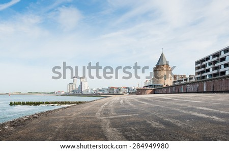 Coastline of Flushing in the Netherlands with in the foreground the historic Prison Tower now restored and in use as a restaurant. - stock photo