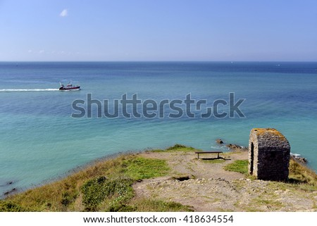Coastline of Granville and fishing boat, a commune in the bay of Saint-Michel in the Manche department in Lower Normandy in north-western France. - stock photo