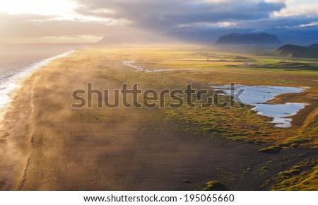 coastline of iceland during sunset. Dyrholey, Iceland - stock photo