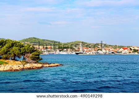 Coastline of old town in Tribunj, Croatia. View from the sea