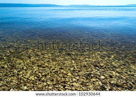 Coastline. The surface of the water with reflections - stock photo