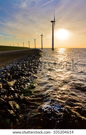 Coastline turbines - stock photo