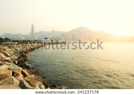 coastline  with cityscape background in hong kong - stock photo