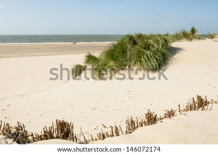 Coastline with dike ,sand and grass in Zeeland, Holland - stock photo