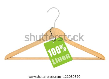 coat hanger with hundred percent linen tag isolated on white background - stock photo