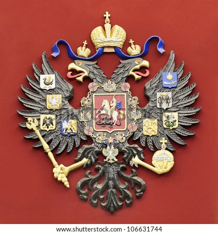 Coat of arms of the Russian Federation on a red background - stock photo