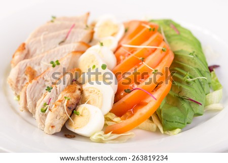 Cobb salad with chicken and eggs isolated on white background - stock photo