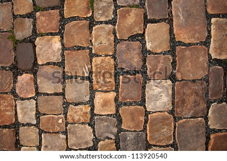 Cobble stone road pattern from Prague, top view - stock photo