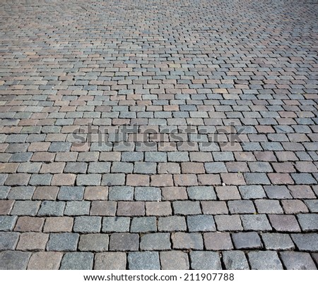Cobble stone street texture or background - stock photo
