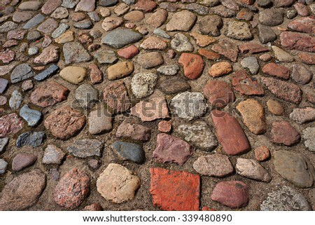 an analysis of the topic of the cobblestone roadways and the roughly built playhouses