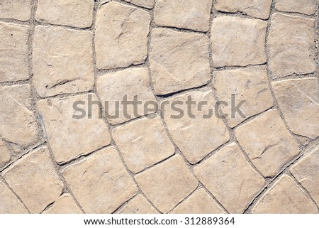Cobble texture, closeup view on details of a modern, mosaic kind cobble found in Greece nowadays.  - stock photo