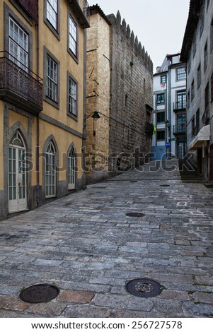 Cobbled, ascending city street in the Old Town of Porto in Portugal. - stock photo